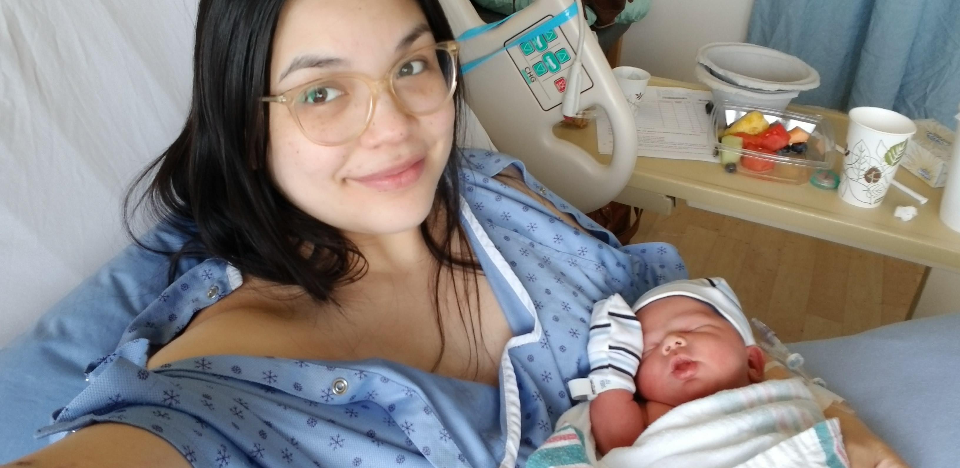 RJH holding her newborn son, Arthur.